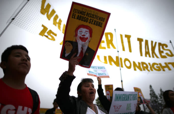 "Fast food workers and supporters protest outside of a McDonald's restaurant for higher wages and union rights as part of the national ""Fight for $15"" movement in Los Angeles, California, U.S., May 24, 2017. REUTERS/Lucy Nicholson - RC13F612FEE0"