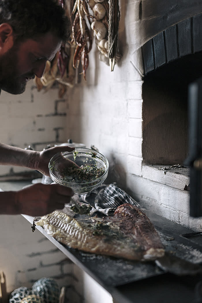 Chef Valentine Warner cooks a Mexican-style cod in a wood-fired oven as part of an unusual menu using locally foraged and caught Norwegian ingredients