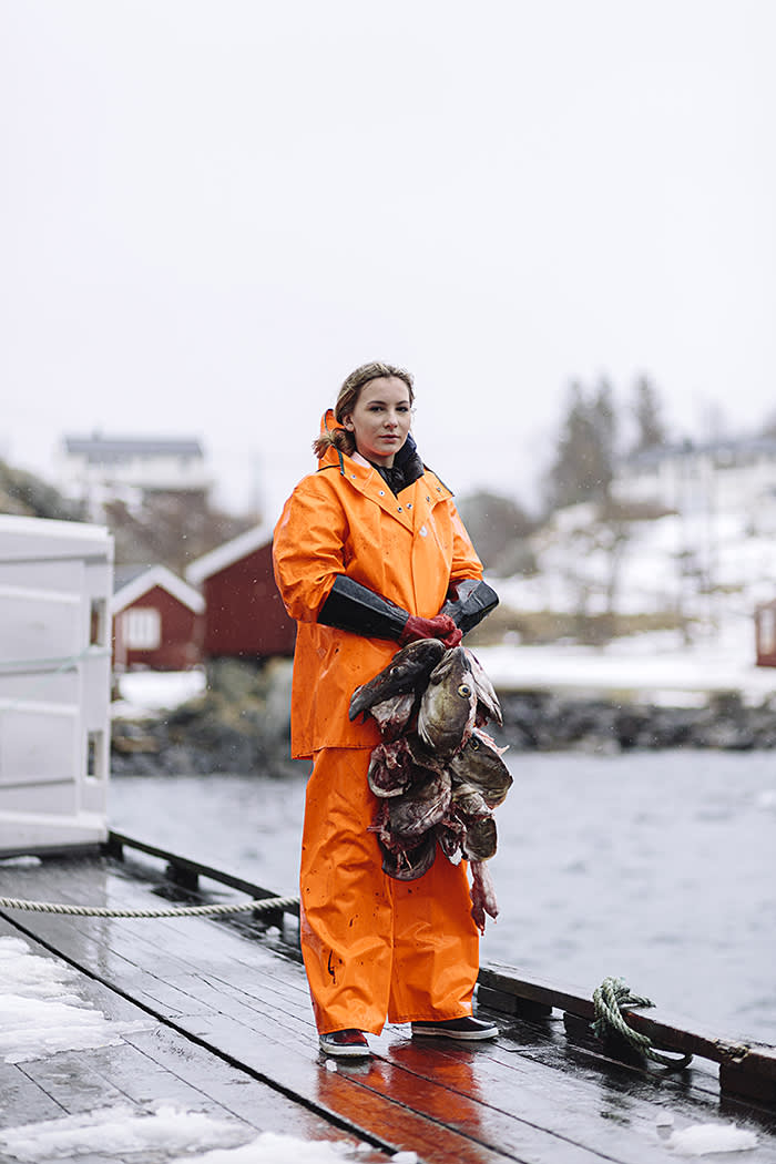 Maria Rasmussen Melhus, Lofoten's champion cod beheader; she and her school friends work in the processing plant during the cod season