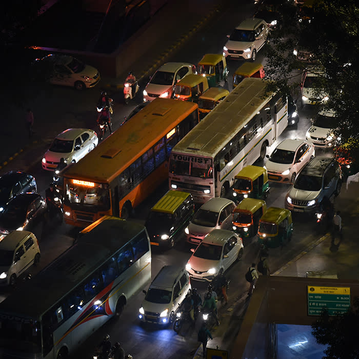 Heavy traffic seen at the a traffic signal in Delhi's Connaught Place on a smoggy evening on 6th November, 2019.