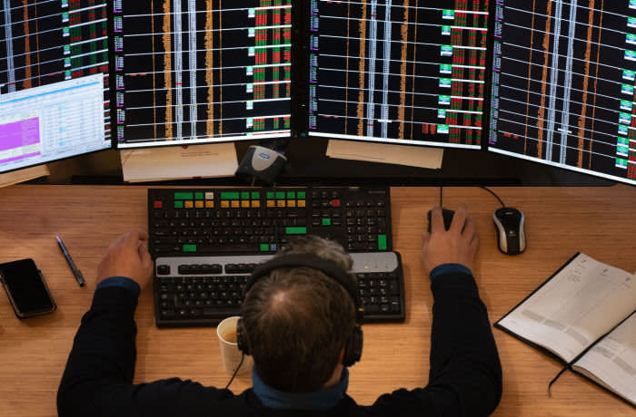 A financial trader monitors data on computer screens on the trading floor inside the Amsterdam Stock Exchange, operated by Euronext NV, in Amsterdam, Netherlands, on Monday, Jan. 7, 2019. European equities erased earlier gains as food and health care shares declined and optimism stemming from Chinas monetary easing evaporated. Photographer: Jasper Juinen/Bloomberg