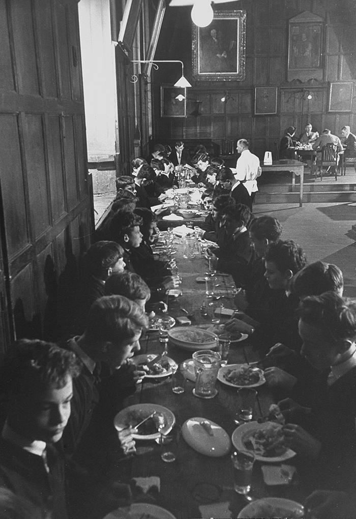 Boys dining at College Hall, Winchester, c1951. Founded in 1382, the school represents the beginning of a tradition of educating the children of the elite to prepare them for university. Eton College, founded in 1440, was modelled on Winchester