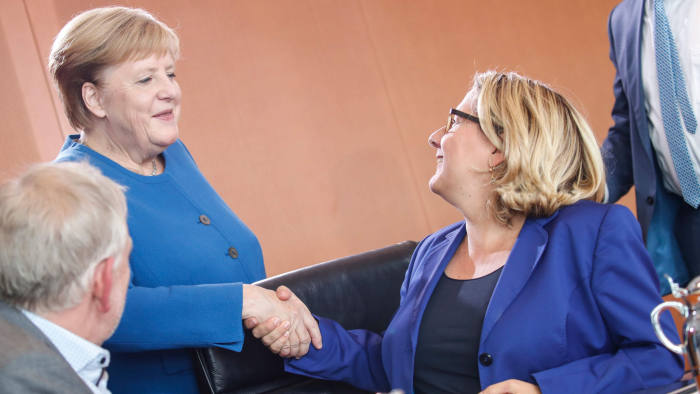 German Environment Minister Svenja Schulze (R) shakes hands with German Chancellor Angela Merkel ahead a climate cabinet meeting on September 20, 2019 in Berlin. - Chancellor Angela Merkel's government struggles to secure a deal on a broad climate plan for Germany despite overnight talks dragging over 16 hours, as protesters rally in the streets demanding change. (Photo by AXEL SCHMIDT / AFP)AXEL SCHMIDT/AFP/Getty Images