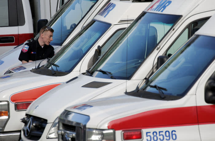 Ambulances are seen in a staging area at the North Kirkland Community Center, which is a short drive from the Life Care Center of Kirkland, the long-term care facility linked to several confirmed coronavirus cases in the state, in Kirkland, Washington, U.S. March 4, 2020. REUTERS/David Ryder