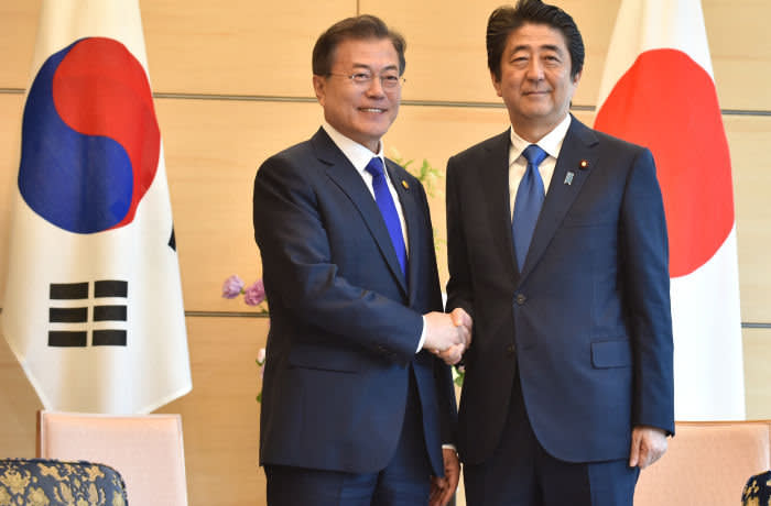 South Korea's President Moon Jae-in (L) shakes hands with Japan's Prime Minister Shinzo Abe (R) prior to their meeting at Abe's official residence in Tokyo on May 9, 2018. - The two leaders met after a trilaterial meeting between Japan, China and South Korea earlier in the day. (Photo by Kazuhiro NOGI / POOL / AFP) (Photo credit should read KAZUHIRO NOGI/AFP/Getty Images)