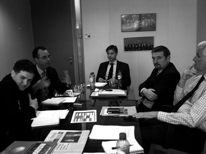 Alex Barker (left) in 2012, a year into the job, in the Berlaymont building in Brussels, with (second from left) the FT's Peter Spiegel and Michel Barnier (right), then the EU Commissioner overseeing financial services