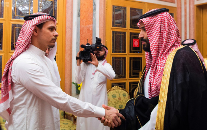 """In this photo released by Saudi Press Agency, SPA, Saudi Crown Prince Mohammed bin Salman, right, shakes hands with Salah Khashoggi, a son, of Jamal Khashoggi, in Riyadh, Saudi Arabia, Tuesday, Oct. 23, 2018. Saudi Arabia, which for weeks maintained that Jamal Khashoggi had left the Istanbul consulate, on Saturday acknowledged he was killed there in a """"fistfight."""" (Saudi Press Agency via AP)"""