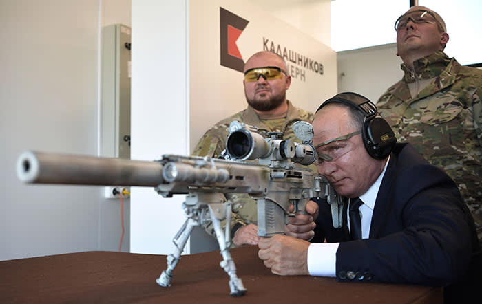 TOPSHOT - Russian President Vladimir Putin looks through the scope as he shoots a Chukavin sniper rifle (SVC-380) during a visit to the military Patriot Park in Kubinka, outside Moscow, on September 19, 2018. (Photo by Alexey NIKOLSKY / SPUTNIK / AFP)ALEXEY NIKOLSKY/AFP/Getty Images