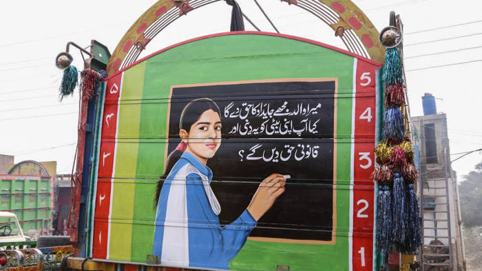 "A brightly coloured painting of a girl hangs across the back of a large truck in Pakistan's province of Punjab. The message beneath it reads, ""My father will give me my rightful share in his property. Will you also give your daughter her due share?"""