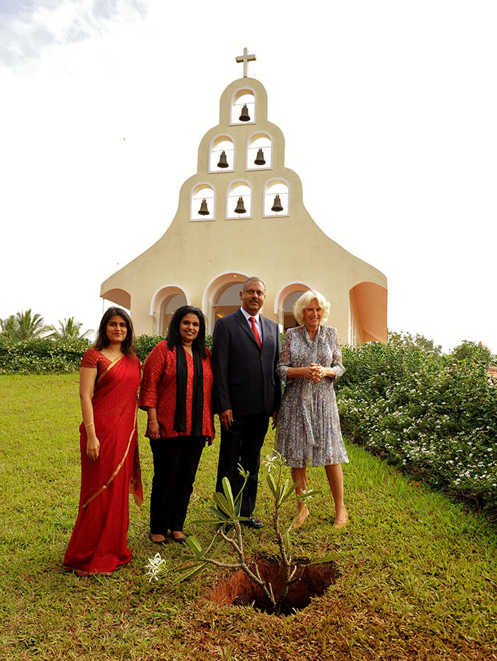 HRH Camilla The Duchess of Cornwall with the Founders of Soukya Dr Issac Mathai, Dr Suja Issac and Ms Anna Issac planting a Plumeria at the Souky's Holy Trinity Chapel. PR provided ( but don't say that )