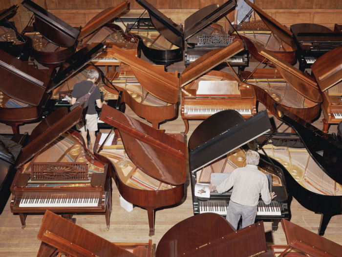 A piano auction at Conway Hall in Holborn, London, photographed for the FT by Harry Mitchell
