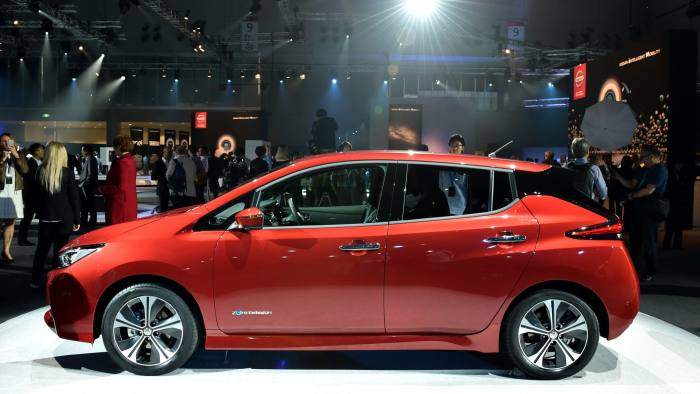 Japan's Nissan Motor displays the company's new Nissan LEAF, the next evolution of the zero-emission electric vehicle, during the world premiere in Makuhari, Chiba prefecture on September 6, 2017. Japanese giant Nissan on September 6 unveiled a new electric car with an extended range and semi-autonomous driving functions, as it seeks to battle off competitors in a sector it once pioneered. / AFP PHOTO / KAZUHIRO NOGI (Photo credit should read KAZUHIRO NOGI/AFP/Getty Images)