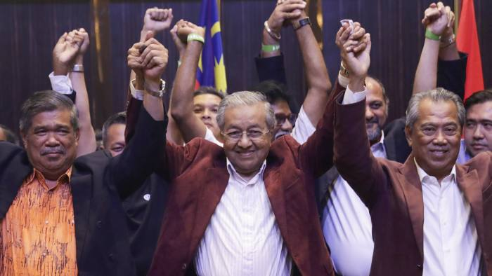epa06724094 Mahathir Mohamad, former Malaysian prime minister and chairman of 'Pakatan Harapan' (The Alliance of Hope) and current prime ministerial candidate, (C) reacts with party members in jubilation during a press conference after the general elections in Petaling Jaya, outside Kuala Lumpur, Malaysia, early 10 May 2018. Mahathir claimed victory in the hotly-contested election. According to the Malaysian election commission, 14.9 million people were eligible to vote for 222 parliamentary seats and 505 state assembly seats. EPA/FAZRY ISMAIL