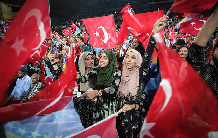 TOPSHOT - Supporters cheer and listen as Turkish President speaks during a pre-election rally in Sarajevo, on May 20, 2018. Recep Tayyip Erdogan holds today the only election rally outside Turkey ahead of the June 24 presidential and parliamentary election. Sarajevo was chosen for the rally after several European Union countries, including Germany, banned such rallies in the campaign for last year's referendum on a new system enhancing the powers of the Turkish presidency. / AFP PHOTO / OLIVER BUNICOLIVER BUNIC/AFP/Getty Images