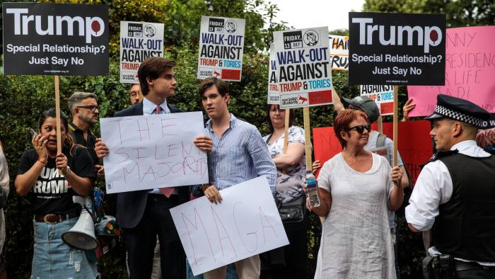 LONDON, ENGLAND - JULY 12: Pro and anti-Donald Trump protesters demonstrate outside Winfield House, the London residence of US ambassador Woody Johnson, where US President Donald Trump and First Lady Melania Trump are staying tonight on July 12, 2018 in London, United Kingdom. The President of the United States and First Lady, Melania Trump, touched down in the UK on Air Force One for their first official visit. Whilst they are here they will have dinner at Blenheim Palace, visit Prime Minister Theresa May at Chequers and take tea with the Queen at Windsor Castle. (Photo by Jack Taylor/Getty Images)