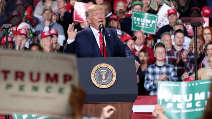 BATTLE CREEK, MICHIGAN - DECEMBER 18: President Donald Trump speaks at a Merry Christmas Rally at the Kellogg Arena on December 18, 2019 in Battle Creek, Michigan. While Trump spoke, the House of Representatives was voting on two articles of impeachment, deciding if he will become the third president in U.S. history to be impeached. (Photo by Scott Olson/Getty Images)