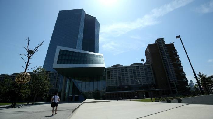 FILE PHOTO: A man walks towards the European Central Bank (ECB) headquarters in Frankfurt, Germany, July 25, 2019. REUTERS/Ralph Orlowski/File Photo