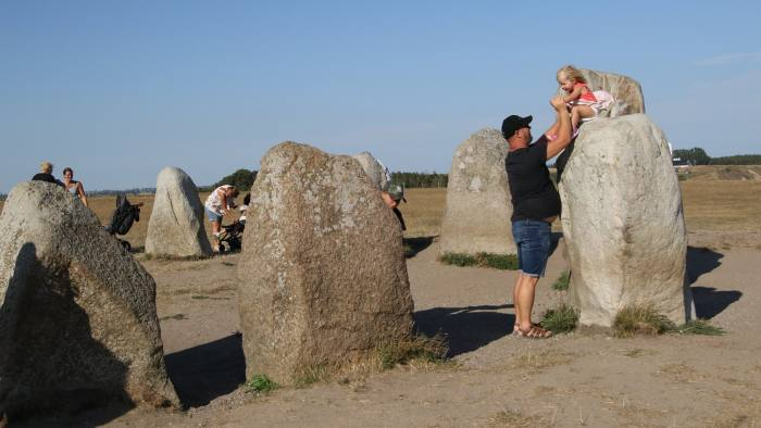 People visiting the Ales Stenar are seen on 2 August 2018 in Kaseberga , Sweden Ales Stenar (Ale's Stones) called also Swedish Stonehenge complex at the hill on the Baltic Sea coast. Ales Stenat is megalithic monument in a stone ship shape oval in outline, with the stones at each end markedly larger than the rest. It is 67-metres long formed by 59 large boulders, weighing up to 1.8 tonnes each. Ales stenar was build probably in 6th or 7th century by the Vikings ancestors (Photo by Michal Fludra/NurPhoto via Getty Images)