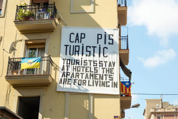 JC4BET Board hanging on a balcony made by neighbours of Barceloneta hood in Barcelona, complaining of holiday apartments