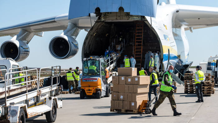 SCHKEUDITZ, GERMANY - APRIL 27: Soldiers of the Bundeswehr, the German armed forces, unload a shipment of 10 million protective face masks and other protective medical gear that had arrived on an Antonov 225 cargo plane from China at Leipzig/Halle Airport during the novel coronavirus crisis on April 27, 2020 in Schkeuditz, Germany. The flight, coordinated by the Bundeswehr, the German armed forces, is one of three that will bring 25 million masks to Germany. Germany currently has approximately 157,000 confirmed cases of Covid-19 infection, of which approximately 103,000 have recovered and 6,0000 have died. (Photo by Jens Schlueter/Getty Images)