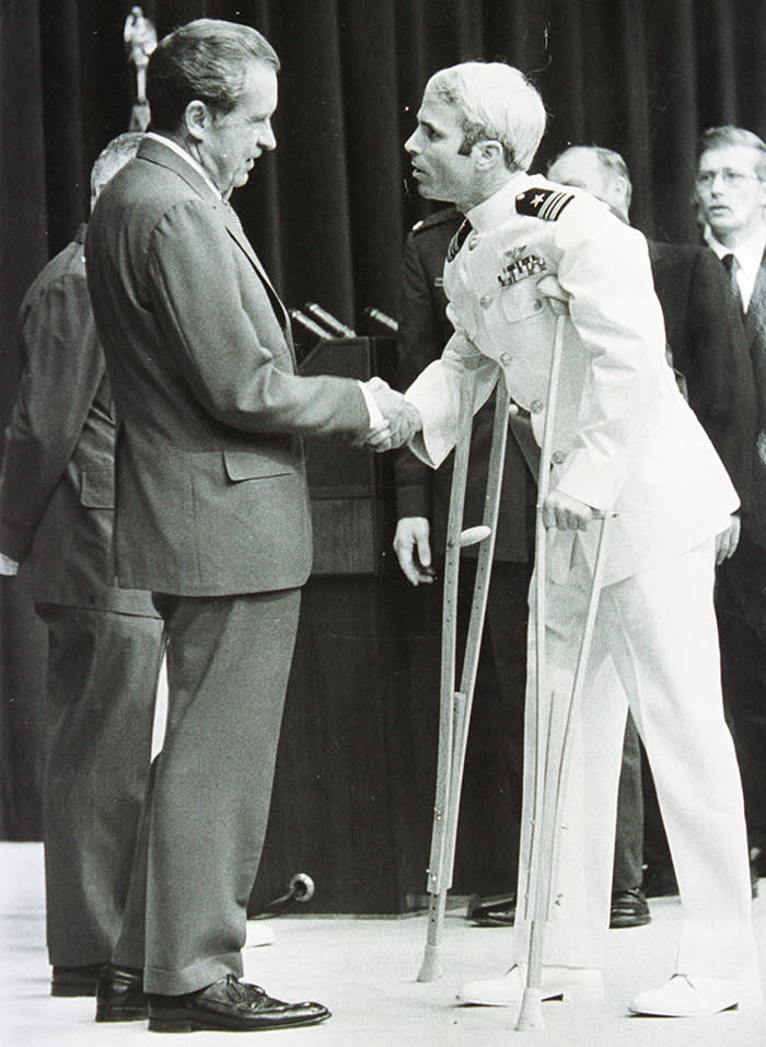 P368426 03: (File Photo) Lieutenant Commander John Mccain Is Welcomed By U.S. President Richard Nixon Upon Mccain's Release From Five And One-Half Years As A P.O.W. During The Vietnam War May 24, 1973 In Washington, D.C. (Photo By Getty Images)