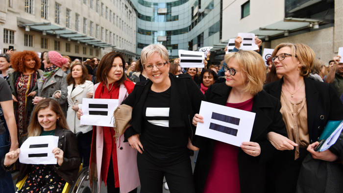 Carrie Gracie (centre) and BBC employees gather outside Broadcasting House in London on International Women's Day to call for equal pay