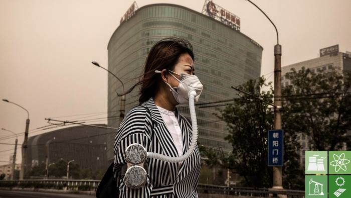 BEIJING, CHINA - MAY 04: A Chinese woman wears a mask to protect from particles blown in during a sandstorm as she walks in the street on May 4, 2017 in Beijing, China. Sandstorms are common in northern China during the spring season and are caused when heavy winds from Mongolia in the north brings sand and pollutants that can blanket Chinese cities and cause air quality to deteriorate. (Photo by Kevin Frayer/Getty Images)