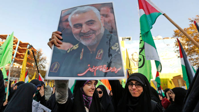 Iranian protesters hold a portrait of the commander of the Iranian Revolutionary Guard's Quds Force, Gen. Qassem Suleimani, during a demonstration in the capital Tehran on December 11, 2017, to denounce US President Donald Trump's declaration of Jerusalem as Israel's capital. (Photo by ATTA KENARE / AFP) (Photo credit should read ATTA KENARE/AFP/Getty Images)