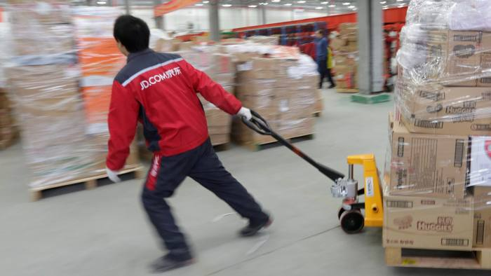 FILE PHOTO: A worker moves goods at a JD.com logistics centre in Langfang, Hebei province, China November 10, 2015. REUTERS/Jason Lee/File Photo