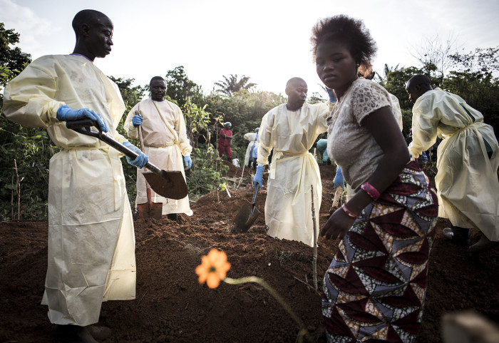 Funeral of Masika Kahongya A family member says her final goodbyes as members of the safe burial team fill in the grave site on July 15, 2019 in Beni.