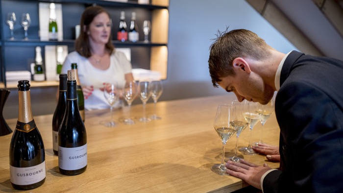 Visitors taste English sparkling wine at Gusbourne Estate winery in Kent on August 13, 2018.