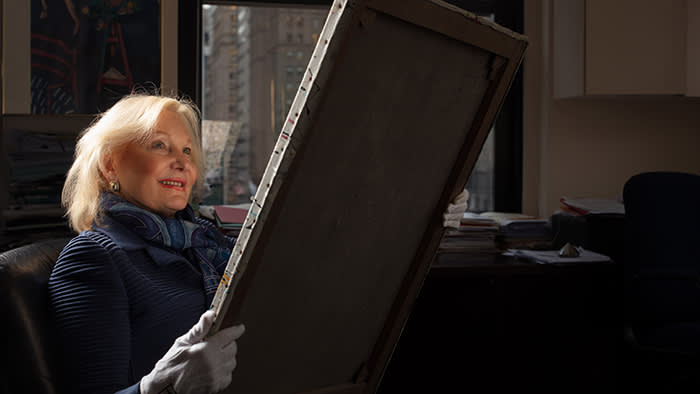 International Foundation for Art Research 's Executive Director, Dr. Sharon Flescher,photographed for the Financial Times looking at a painting submitted for review.