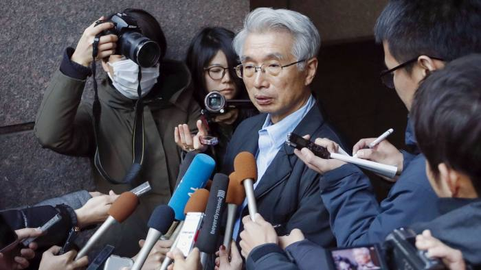 """Junichiro Hironaka, center, lawyer for Nissan's former chairman Carlos Ghosn, speaks to the media in Tokyo, Tuesday, Dec. 31, 2019. Ghosn says from Lebanon he was not fleeing justice but instead left Japan to avoid """"injustice and political persecution""""over financial misconduct allegations. Ghosn had been released on bail while awaiting trial but was not allowed to travel overseas. It's not clear how he left Japan, where he had been under surveillance.(Fumine Tsutabayashi/Kyodo News via AP)"""
