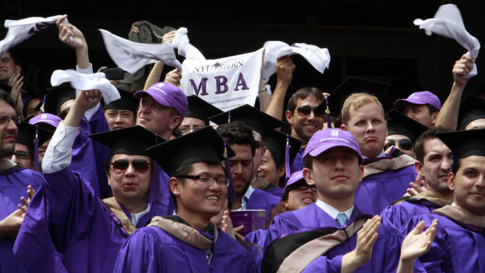 Graduates from the Leonard N. Stern School of Business cheer and wave