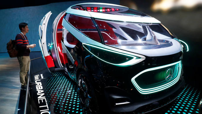 Carmakers temper their enthusiasm for driverless technology