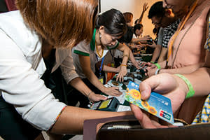 People paying with their ATM cards
