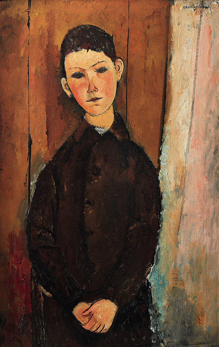 """AMEDEO MODIGLIANI 1884 - 1920 """"JEUNE HOMME ASSIS, LES MAINS CROISÉES SUR LES GENOUX"""" signed Modigliani (upper right) oil on canvas 92 by 60cm. 36¼ by 23⅝in. Painted in 1918."""