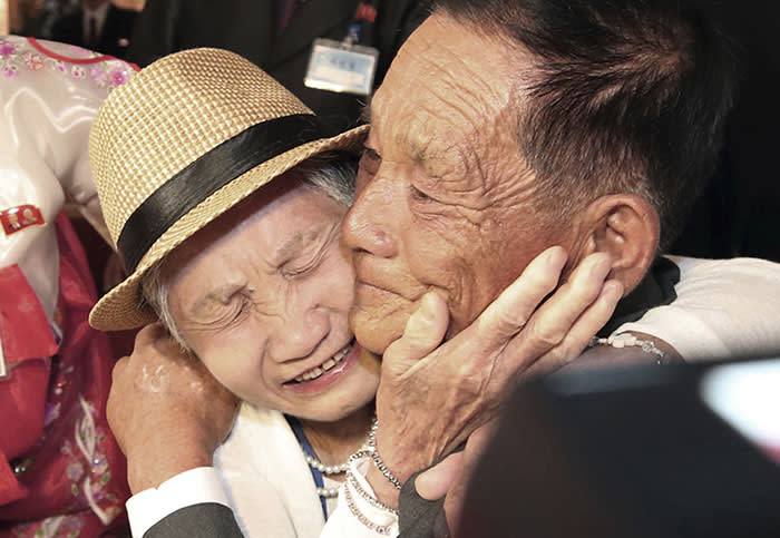 South Korean Lee Keum-seom, 92, left, weeps with her North Korean son Ri Sang Chol, 71, during the Separated Family Reunion Meeting at the Diamond Mountain resort in North Korea, Monday, Aug. 20, 2018. Dozens of elderly South Koreans crossed the heavily fortified border into North Korea on Monday for heart-wrenching meetings with relatives most haven't seen since they were separated by the turmoil of the Korean War. (Lee Ji-eun/Yonhap via AP)