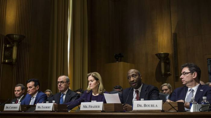 Ken Frazier, chairman and chief executive officer of Merck & Co., second right, testifies during a Senate Finance Committee hearing on drug pricing on Capitol Hill in Washington, D.C., U.S., on Tuesday, Feb. 26, 2019. Top executives from seven of the world's biggest drug companies are testifying before Congress to talk about drug costs, a long-awaited session that could kickstart legislation to rein in prices.Photographer: Zach Gibson/Bloomberg