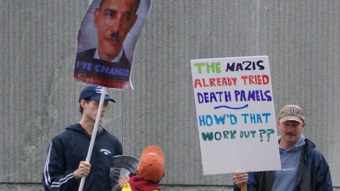 Protesters with 'death panel' Obamacare signs.