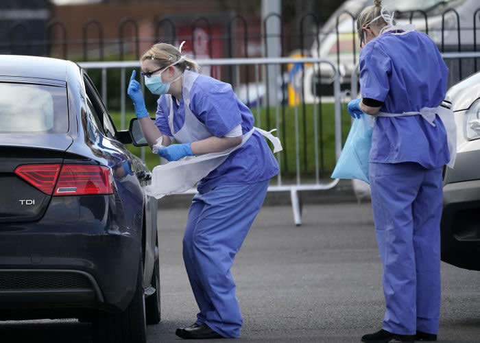 WOLVERHAMPTON, ENGLAND - MARCH 12: A member of the public is swabbed at a drive through Coronavirus testing site set up in a car park on March 12, 2020 in Wolverhampton, England. The National Health Service facility has been set up in a car park to allow people with NHS referrals to be swabbed for Covid-19. (Photo by Christopher Furlong/Getty Images)