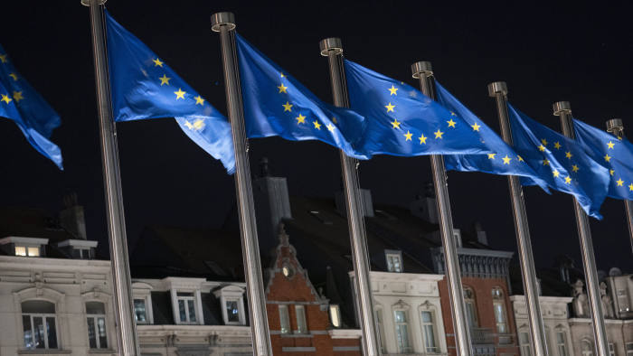 European Union (EU) flags fly outside the Berlaymont building, which houses the headquarters of the European Commission, in Brussels, Belgium, on Wednesday, Nov. 14, 2018. Barnier set out some of the areas in which the U.K. has agreed to stick to EU standards, including taxation, environment, and labor standards. Photographer: Jasper Juinen/Bloomberg