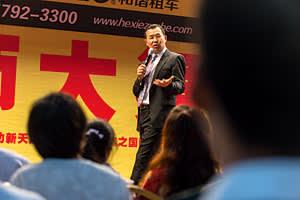 Motivational speaker Zhang Bing on stage
