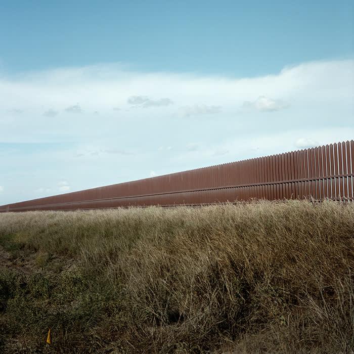 McALLEN, TX - JUNE 8: The international border fence runs along agricultural fields outside of McAllen, TX, on Friday, June 8, 2018.