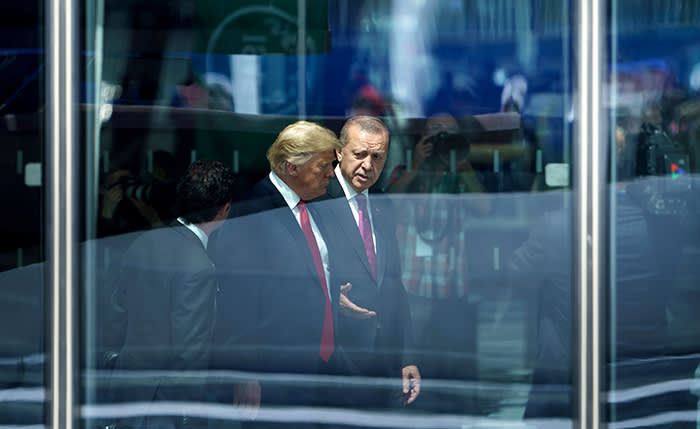 TOPSHOT - US President Donald Trump (L) and Turkey's President Recep Tayyip Erdogan (R) speak as they attend the NATO (North Atlantic Treaty Organization) summit at the NATO headquarters in Brussels on July 11, 2018. / AFP PHOTO / Brendan SmialowskiBRENDAN SMIALOWSKI/AFP/Getty Images