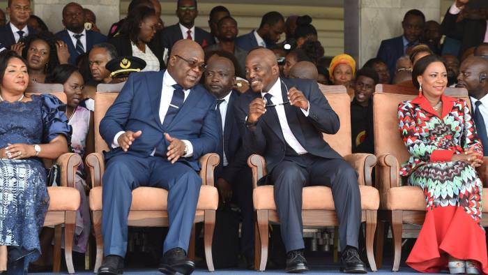Democratic Republic of Congo's outgoing President Joseph Kabila sits next to his successor Felix Tshisekedi during an inauguration ceremony whereby Tshisekedi will be sworn into office as the new president of the Democratic Republic of Congo at the Palais de la Nation in Kinshasa, Democratic Republic of Congo January 24, 2019. REUTERS/ Olivia Acland