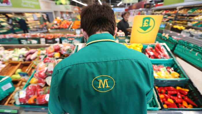 An employee works on the fresh vegetable display at a Morrisons supermarket, operated by William Morrisons Supermarkets Plc, in Crawley, U.K., on Tuesday, March 3, 2015. Wm Morrison Supermarkets Plc named David Potts as chief executive officer, tasking the former head of Tesco Plc's Asia unit with reviving the ailing British grocer. Photographer: Chris Ratcliffe/Bloomberg
