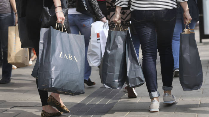 File photo dated 15/09/14 of shoppers on Oxford Street in central London. Britain's army of small high street firms will be given rare good news on Monday when they share tax cuts worth half a billion pounds as business rates bills are slashed across England.