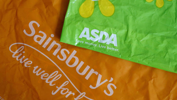 FILE PHOTO: Shopping bags from Asda and Sainsbury's are seen in Manchester, Britain April 30, 2018. REUTERS/Phil Noble/File Photo