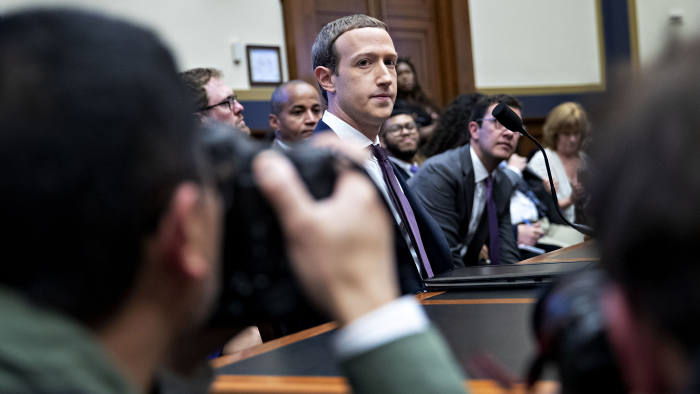 Mark Zuckerberg, chief executive officer and founder of Facebook Inc., arrives after a break during a House Financial Services Committee hearing in Washington, D.C., U.S., on Wednesday, Oct. 23, 2019. Zuckerberg struggled to convince Congress of the merits of the company's plans for a cryptocurrency in light of all the other challenges the company has failed to solve. Photographer: Andrew Harrer/Bloomberg